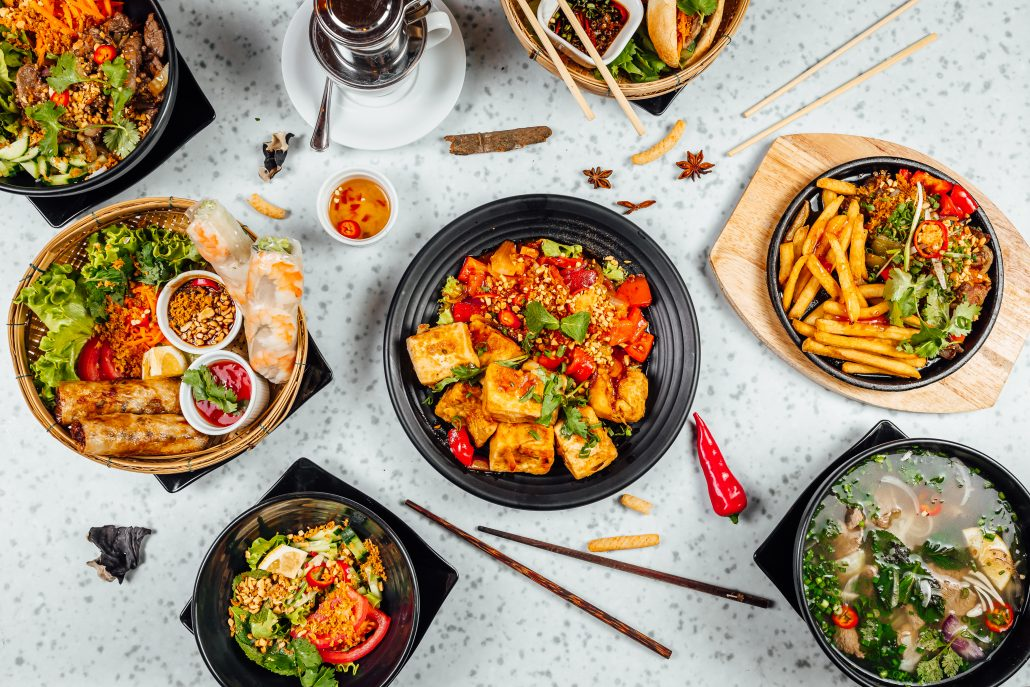 delicious vietnamese food including pho ga noodles spring rolls white table