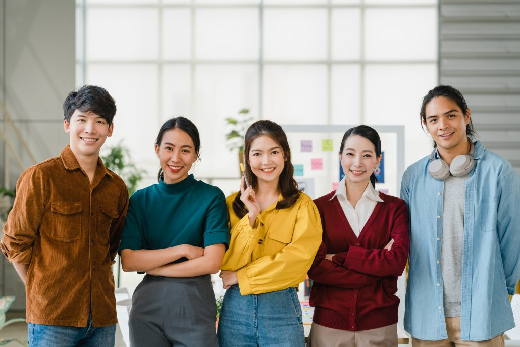 group asia young creative people smart casual wear smiling arms crossed creative office workplace diverse asian male female stand together startup coworker teamwork concept